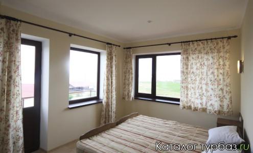 Люкс-спальня с видом на море